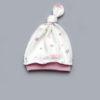 Шапочка с узлом для новорожденной девочки